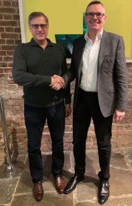Marty Sprinzen (VANTIQ) and Henry Blythe shaking hands (Arch)