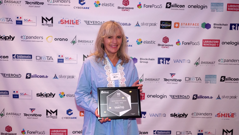 Isabelle Charron-Goupil of VANTIQ posing with award