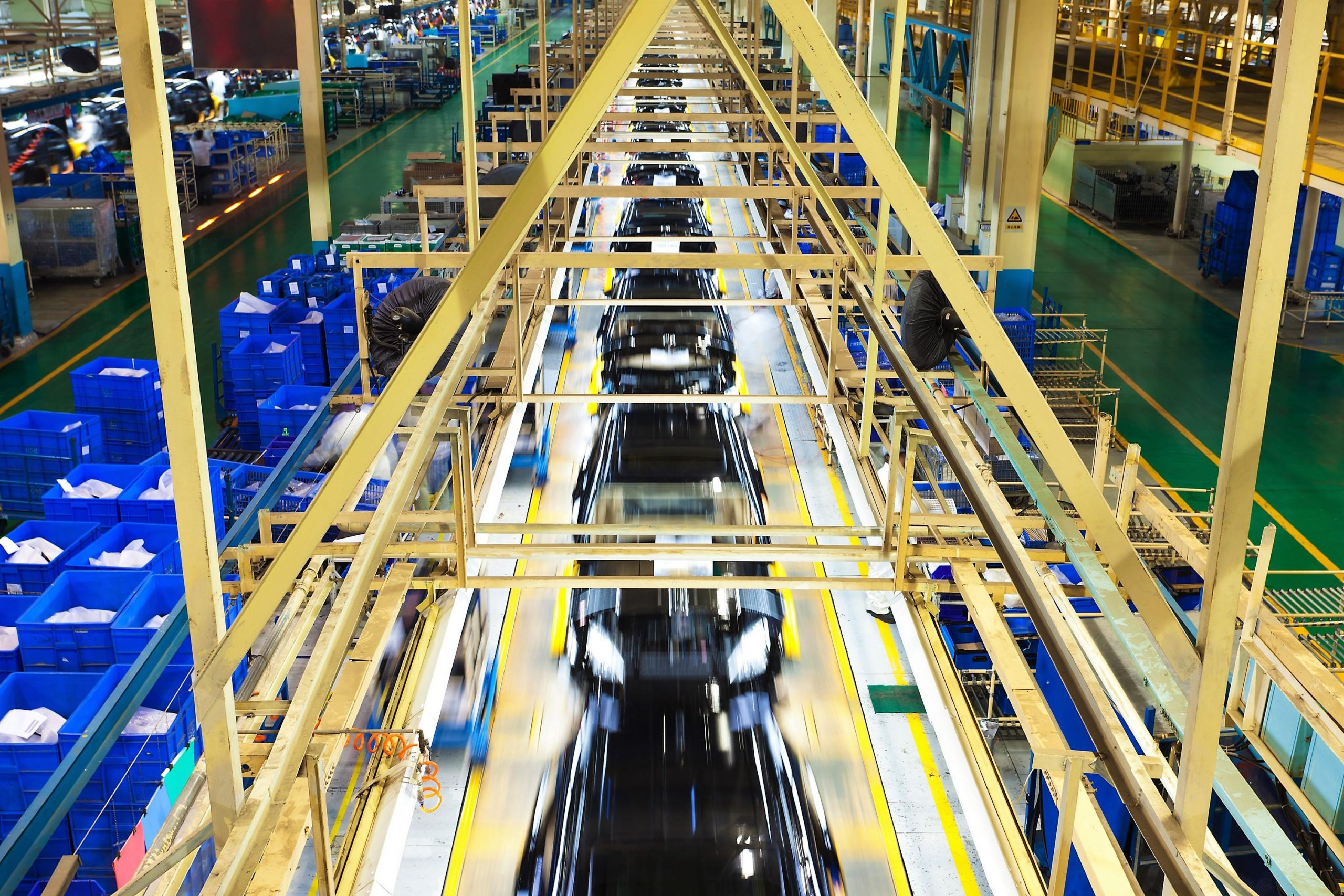 cars moving across manufacturing line