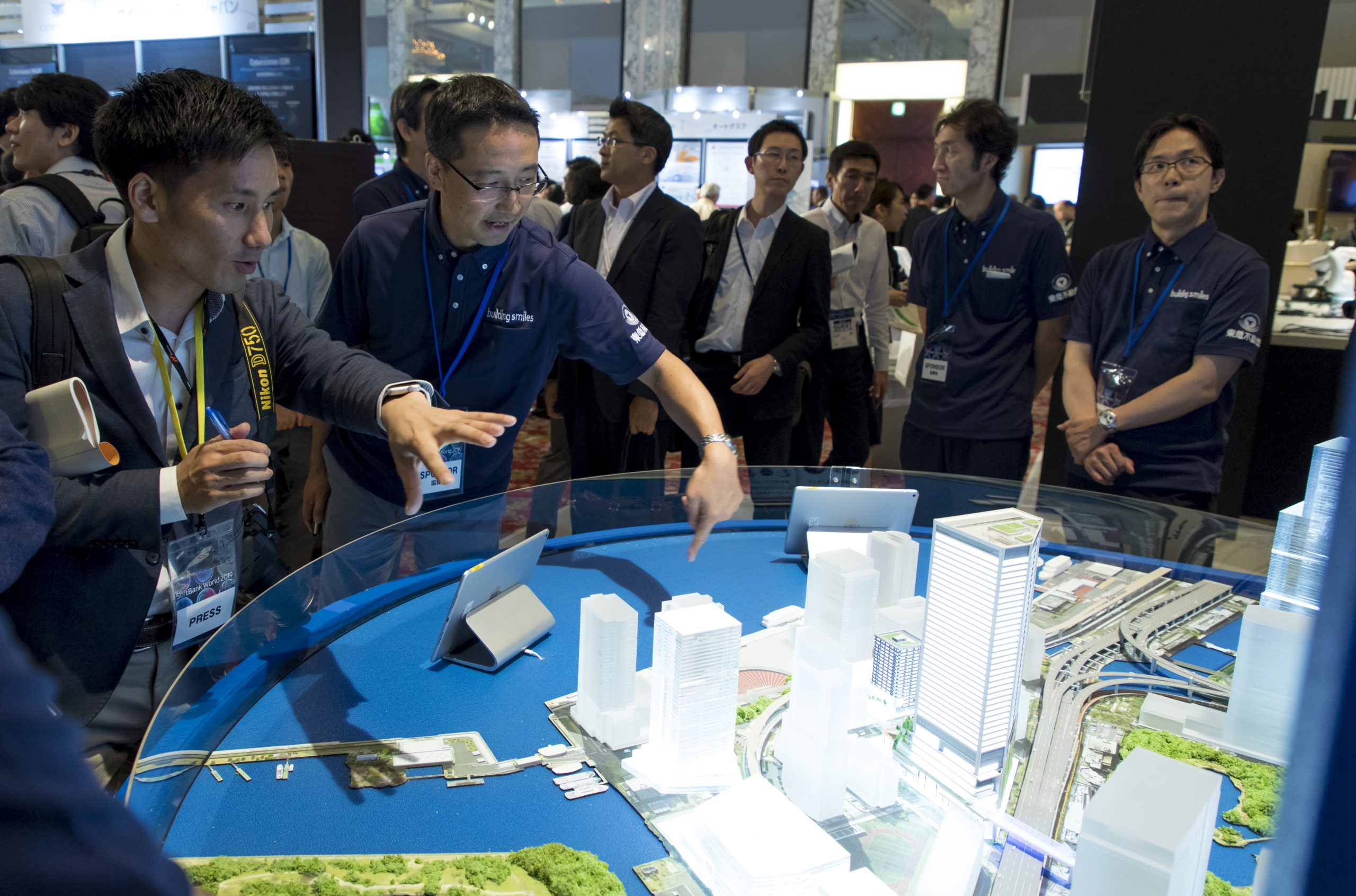 People looking at map of new SoftBank headquarters in Tokyo at SoftBank World 2019