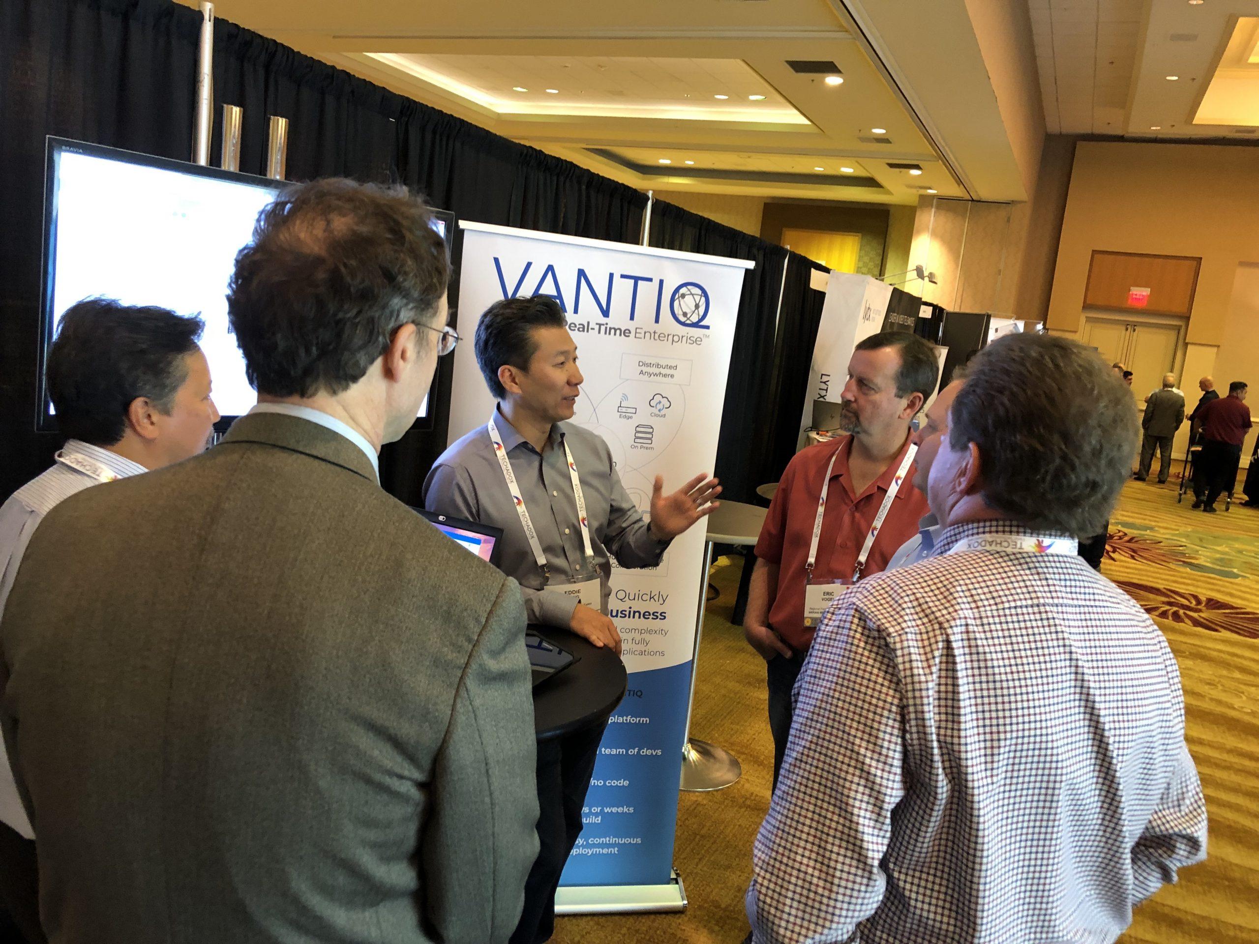 Eddie Tung, Mark Silva and Robert Biczek talking to other participants at VANTIQ booth