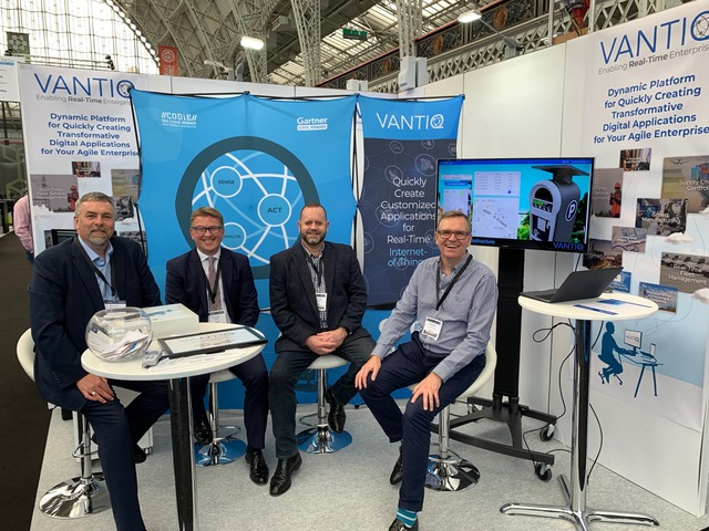 Scott Yarnell, Mark Munro, Clinton James and Henry Blythe sitting at VANTIQ booth at IoT tech expo at London, UK