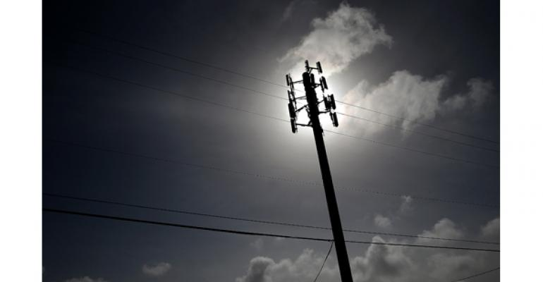 telephone pole with sun shadow in background