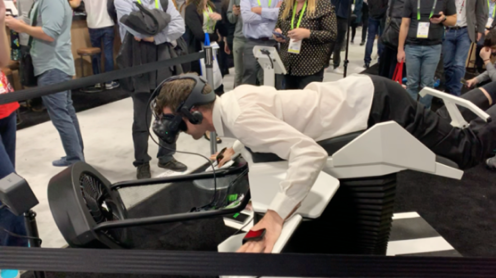people trying bird flight simulator at CES event 2019 in Las Vegas