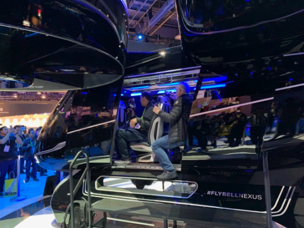 people riding the AR/VR Google assistant amusement park at CES 2019 in Las Vegas