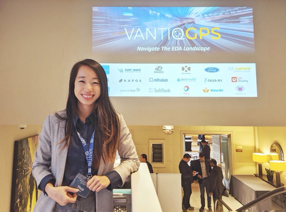 Thuy Tran standing in front of VANTIQ GPS sign