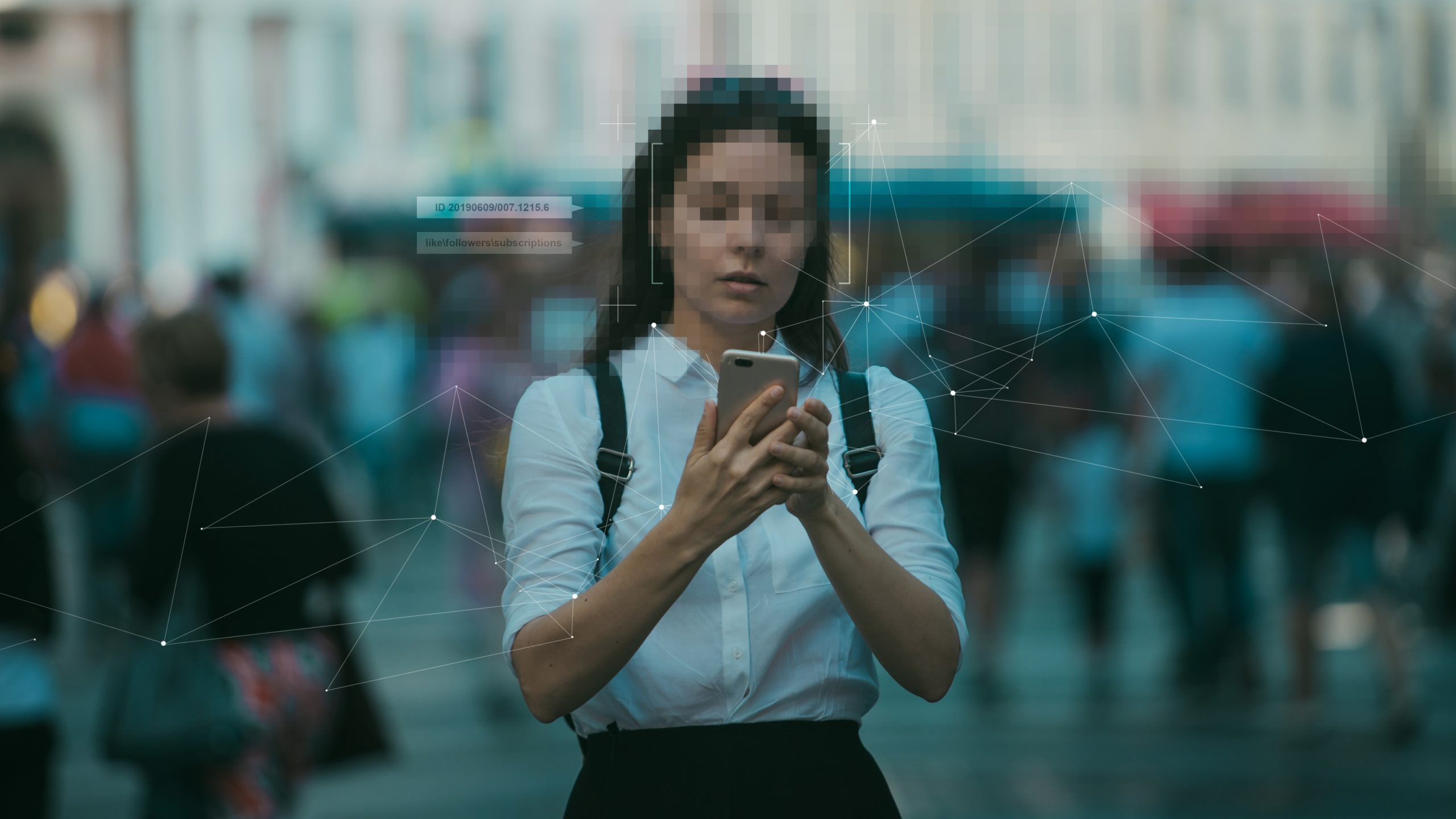 woman with blurred face holding phone