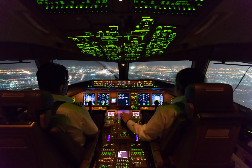Airplane cockpit with pilots