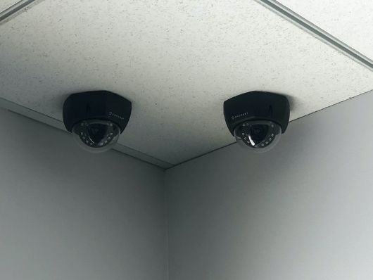 two amcreset cameras mounted on ceiling